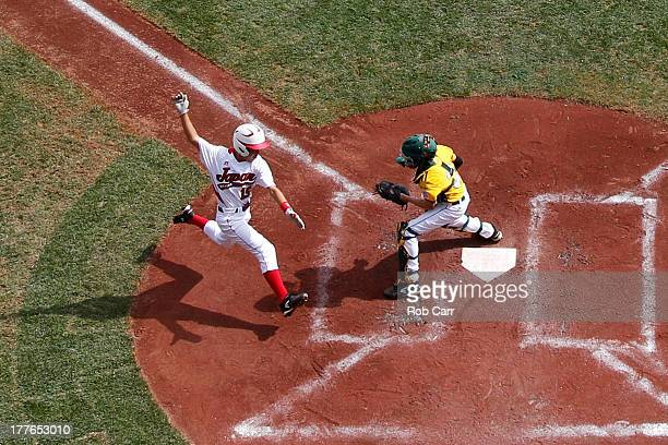 Catcher Patrick Archer of the West team from Chula Vista Ca waits to tag out Takuma Gomi of the Tokyo Japan team at the plate during the Little...
