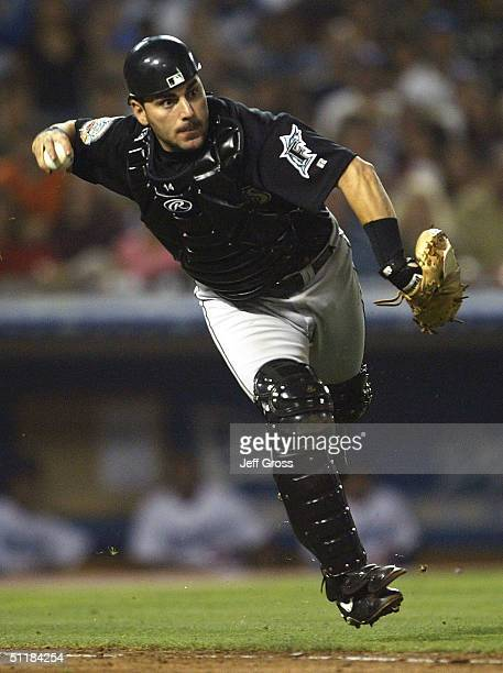 Catcher Paul Lo Duca of the Florida Marlins throws to first base for an out against the Los Angeles Dodgers on August 17 2004 at Dodger Stadium in...