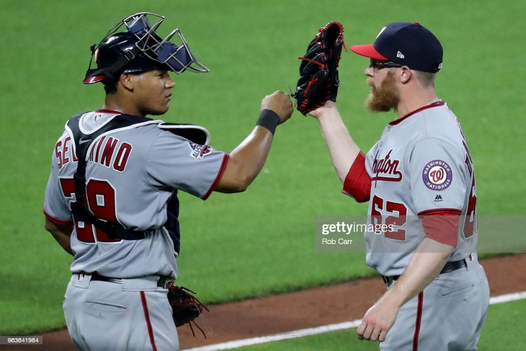 Catcher Pedro Severino #29 and pitcher Sean Doolittle #62 of the Washington Nationals celebrate following the Nationals3-2win over the Baltimore Orioles at Oriole Park at Camden Yards on May 29, 2018 in Baltimore, Maryland.