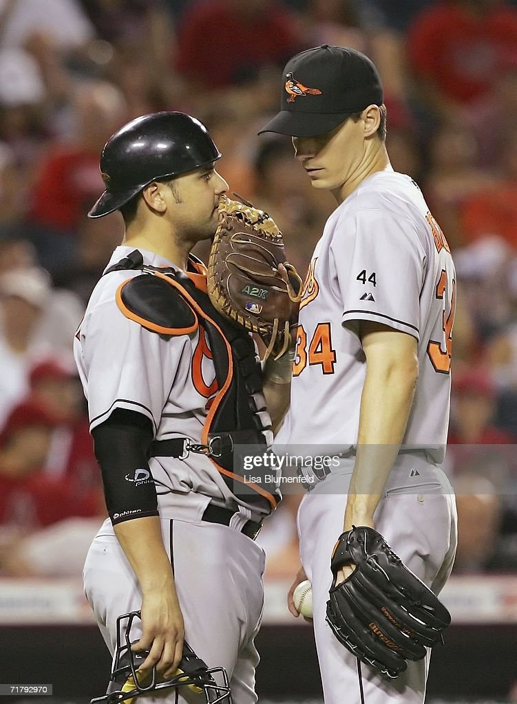 Catcher Ramon Hernandez #55 and pitcher Kris Benson #34 of the Baltimore Orioles have a meeting in the eighth inning against the Los Angeles Angels of Anaheim on September 5, 2006 at Angel Stadium in Anaheim, California. The Angels won 5-2.