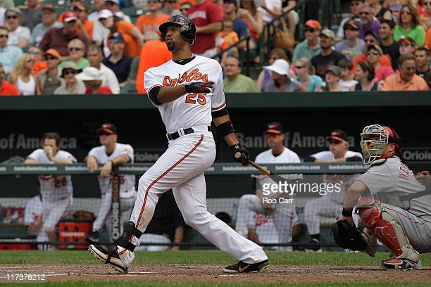 Catcher Ramon Hernandez of the Cincinnati Reds looks on as Derrek Lee of the Baltimore Orioles follows his fourth inning three run home run at Oriole...