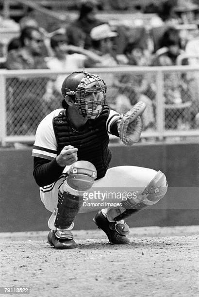 Catcher Ray Fosse oc the Cleveland Indians reaches for a warm up pitch prior to the start of an inning during a game in 1972 at Municipal Stadium in...