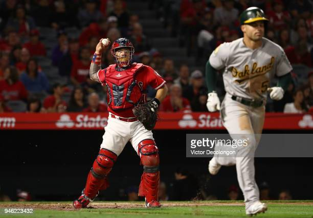 Catcher Rene Rivera of the Los Angeles Angels of Anaheim throws to first base in the eighth inning during the MLB game against the Oakland Athletics...