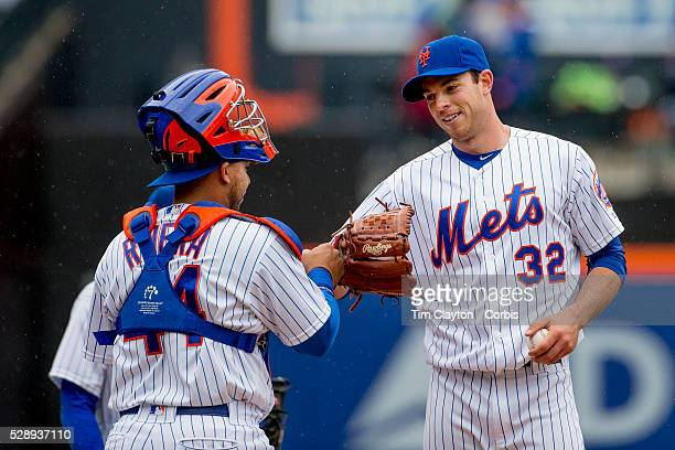 Catcher Rene Rivera of the New York Mets congratulates pitcher Steven Matz as he is pulled from the game after conceding only two hits during the...