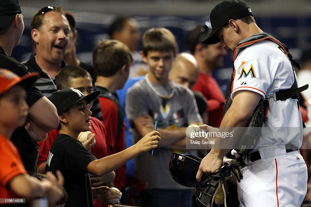 Catcher Rob Brantley #19 of the Miami Marlins signs autographs during batting practice prior to playing against the St. Louis Cardinals at Marlins Park on June 15, 2013 in Miami, Florida.