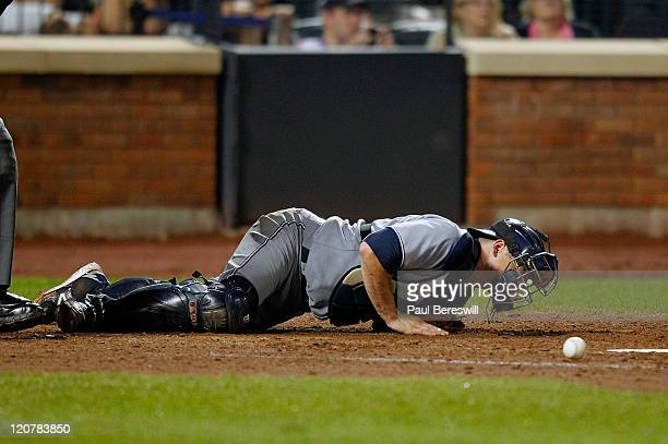 Catcher Rob Johnson of the San Diego Padres lies on the ground after being hit by a foul ball during a Major League Baseball game against the New...
