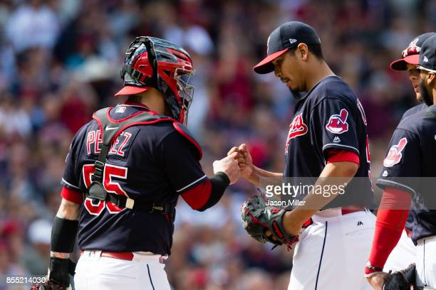Catcher Roberto Perez celebrates with starting pitcher Carlos Carrasco of the Cleveland Indians as Carrasco leaves the game during the ninth inning...