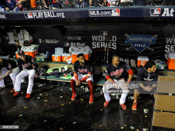 Catcher Roberto Perez firstbaseman Carlos Santana and leftfielder Coco Crisp of the Cleveland Indians sit in the dugout during a rain delay prior to...