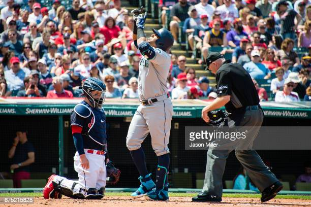 Catcher Roberto Perez of the Cleveland Indians and home plate umpire Ron Kulpa watch as Nelson Cruz of the Seattle Mariners celebrates after hitting...