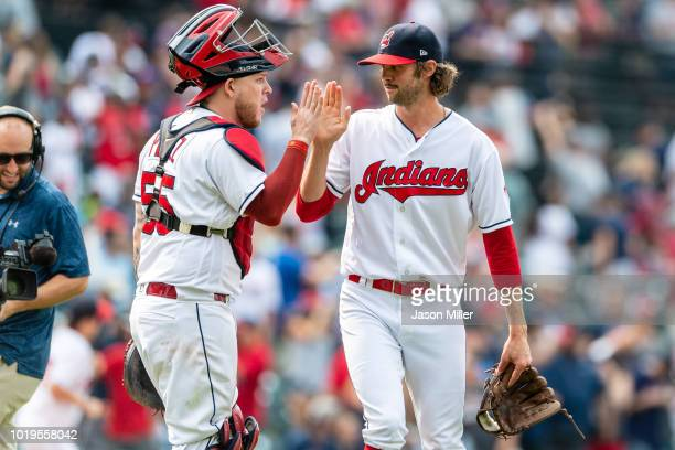 Catcher Roberto Perez of the Cleveland Indians celebrates with closing pitcher Adam Cimber after a win over the Baltimore Orioles at Progressive...