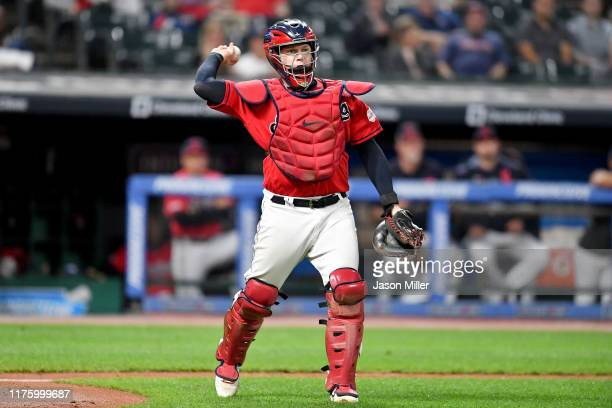 Catcher Roberto Perez of the Cleveland Indians throws to first after Jeimer Candelario of the Detroit Tigers struck out swinging to end the top of...