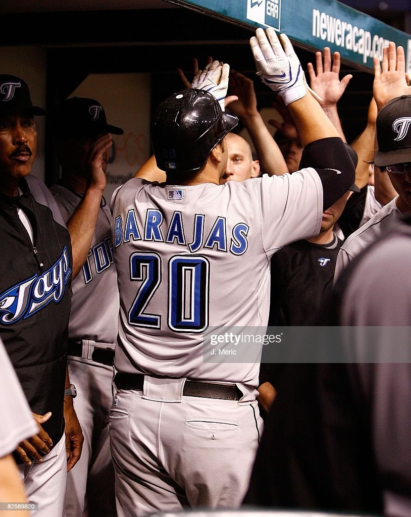 Catcher Rod Barajas #20 of the Toronto Blue Jays is congratulated by his teammates after his homerun against the Tampa Bay Rays during the game on August 26, 2008 at Tropicana Field in St. Petersburg, Florida.