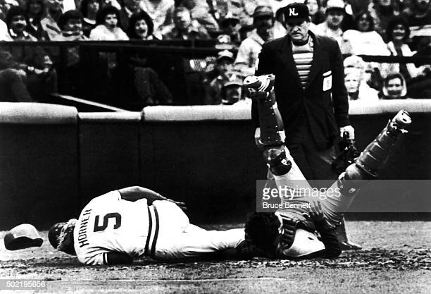 Catcher Ron Hodges of the New York Mets is ran over by Bob Horner of the Atlanta Braves as umpire Satch Davidson called Horner out on the play on...