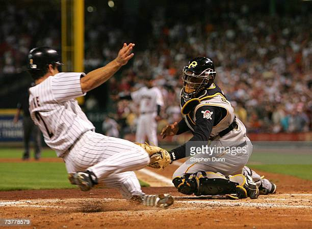 Catcher Ronny Paulino of the Pittsburgh Pirates tags out Chris Burke of the Houston Astros on April 2 2007 at Minute Maid Park in Houston Texas