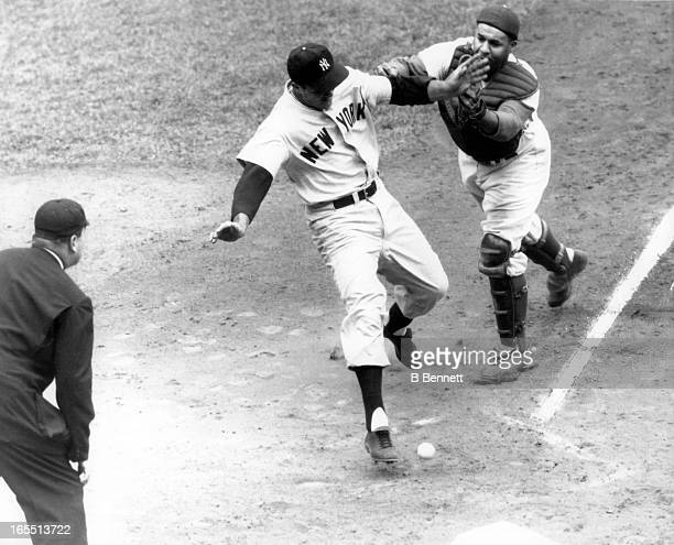 Catcher Roy Campanella of the Brooklyn Dodgers can't handle the ball as Bill 'Moose' Skowron of the New York Yankees scores during Game 3 of the 1955...