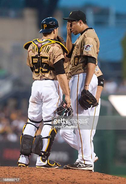 Catcher Russell Martin and pitcher Jeanmar Gomez of the Pittsburgh Pirates talk on the mound after giving up three runs in the fifth inning to the...