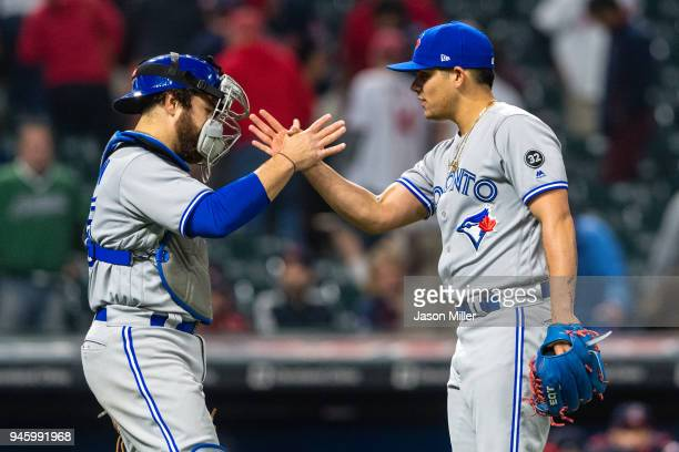 Catcher Russell Martin celebrates with closing pitcher Roberto Osuna of the Toronto Blue Jays after the Blue Jays defeated the Cleveland Indians at...