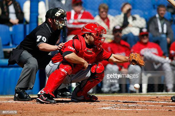 Catcher Russell Martin of Team Canada catches against the Toronto Blue Jays during a exhibition spring training game at Dunedin Stadium on March 3...