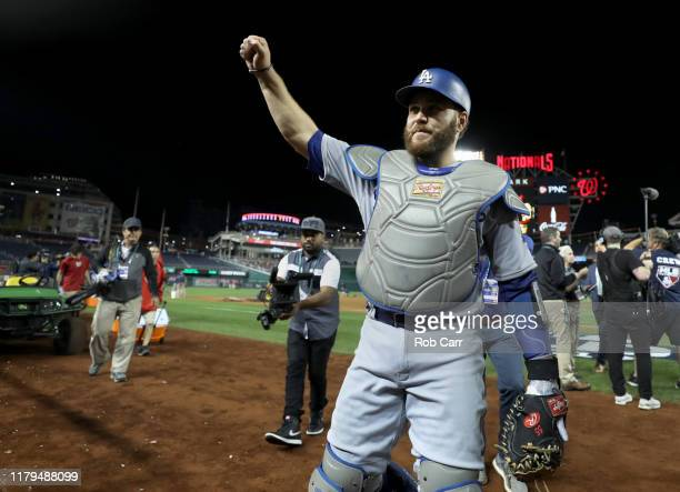Catcher Russell Martin of the Los Angeles Dodgers acknowledges the crowd after the Dodgers defeated the Washington Nationals 104 in Game 3 of the...