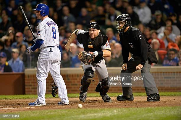 Catcher Russell Martin of the Pittsburgh Pirates moves to get a wild pitch as Donnie Murphy of the Chicago Cubs bats during the eighth inning at...