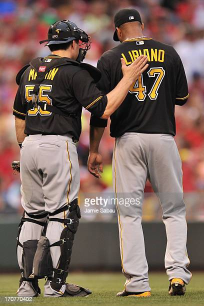 Catcher Russell Martin of the Pittsburgh Pirates offers encouragement to pitcher Francisco Liriano of the Pittsburgh Pirates during the third inning...