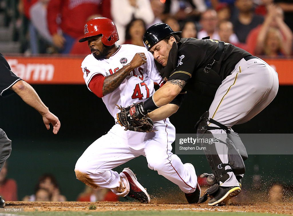 Catcher Russell Martin #55 of the Pittsburgh Pirates tags out Howie Kendrick #47 of the Los Angeles Angels of Anaheim as he tries to score from second base on a single by Erick Aybar in the fourth inning at Angel Stadium of Anaheim on June 22, 2013 in Anaheim, California.