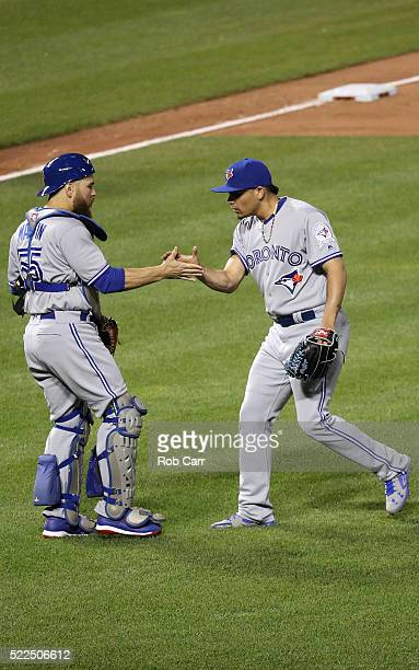 Catcher Russell Martin of the Toronto Blue Jays and closer Roberto Osuna celebrate following the Blue Jays 43 win over the Baltimore Orioles at...