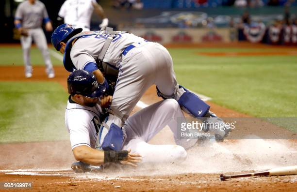 Catcher Russell Martin of the Toronto Blue Jays gets the out at home plate on Steven Souza Jr #20 of the Tampa Bay Rays as Souza attempts to score...