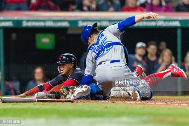 Catcher Russell Martin of the Toronto Blue Jays tags out Francisco Lindor of the Cleveland Indians at home to end the sixth inning at Progressive...