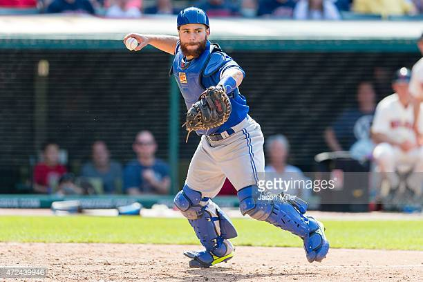 Catcher Russell Martin of the Toronto Blue Jays throws out Brandon Moss of the Cleveland Indians at first during the eighth inning against the...