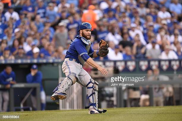 Catcher Russell Martin of the Toronto Blue Jays throws to first base after fielding a bunt in the game against the Kansas City Royals on August 6...