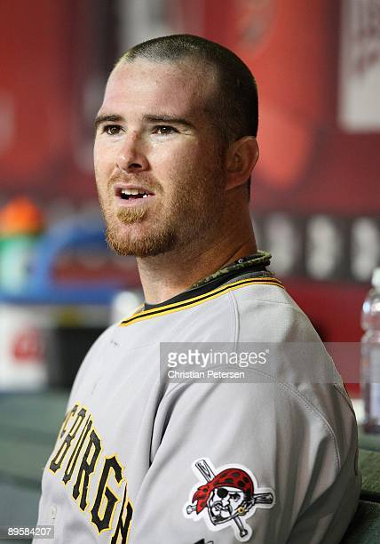 Catcher Ryan Doumit of the Pittsburgh Pirates sits in the dugout during the major league baseball game against the Arizona Diamondbacks at Chase...