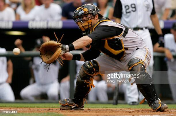 Catcher Ryan Doumit of the Pittsburgh Pirates takes a throw at the plate against the Colorado Rockies at Coors Field on July 19 2008 in Denver...