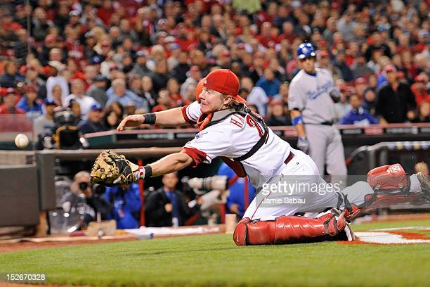 Catcher Ryan Hanigan of the Cincinnati Reds dives for but misses a foul ball in the seventh inning against the Los Angeles Dodgers at Great American...
