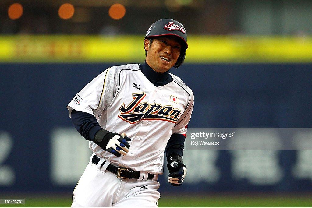 Catcher Ryoji Aikawa #2 of Japan celebrates a three run home run in the bottom half of the eighth inning during international friendly game between Japan and Australia at Kyocera Dome Osaka on February 23, 2013 in Osaka, Japan.