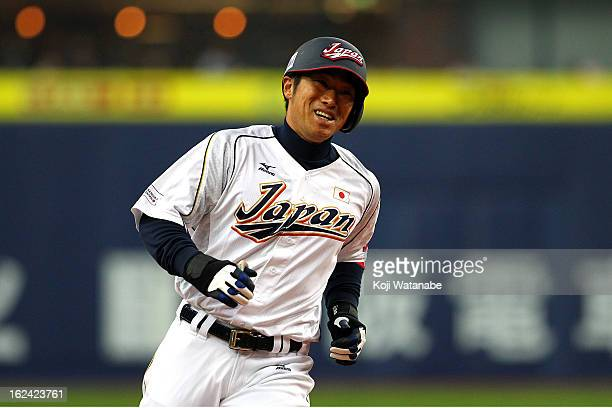 Catcher Ryoji Aikawa of Japan celebrates a three run home run in the bottom half of the eighth inning during international friendly game between...