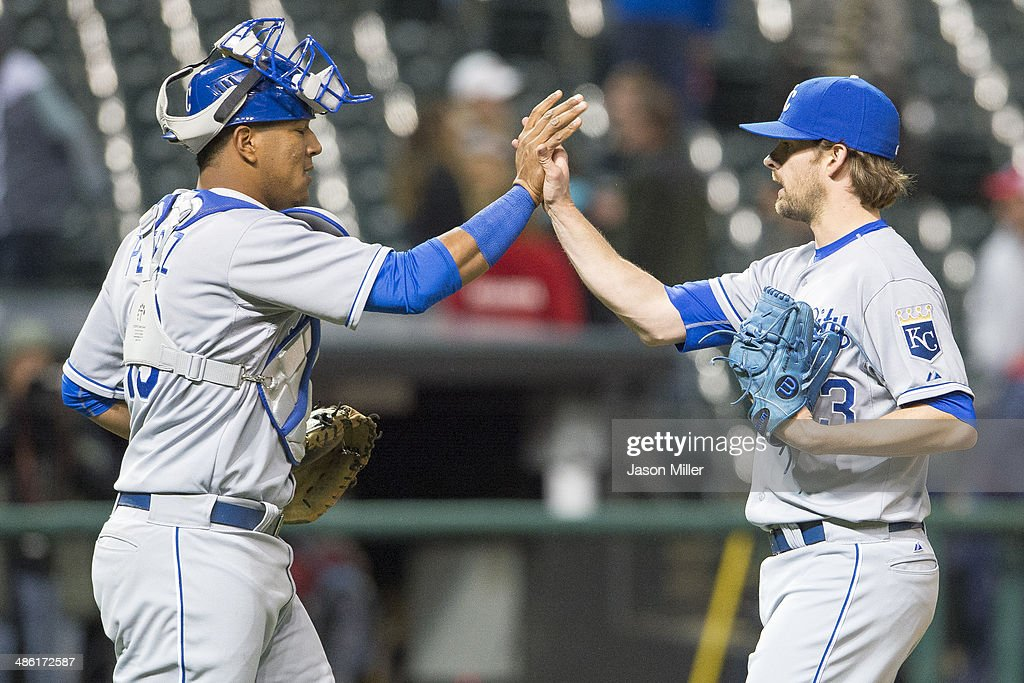 Catcher Salvador Perez #13 celebrates with closing pitcher Aaron Crow #43 of the Kansas City Royals after the Royals defeated the Cleveland Indians at Progressive Field on April 22, 2014 in Cleveland, Ohio. The Royals defeated the Indians 8-2.