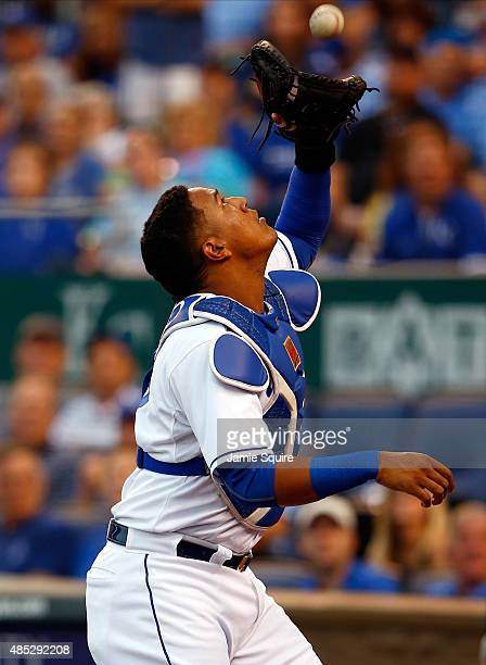 Catcher Salvador Perez of the Kansas City Royals catches a popup during the game against the Baltimore Orioles at Kauffman Stadium on August 26 2015...