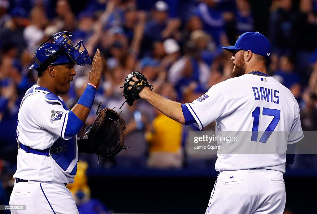 Catcher Salvador Perez #13 of the Kansas City Royals high fives closer Wade Davis #17 after the Royals defeated the Detroit Tigers 8-6 to win the game at Kauffman Stadium on April 19, 2016 in Kansas City, Missouri.