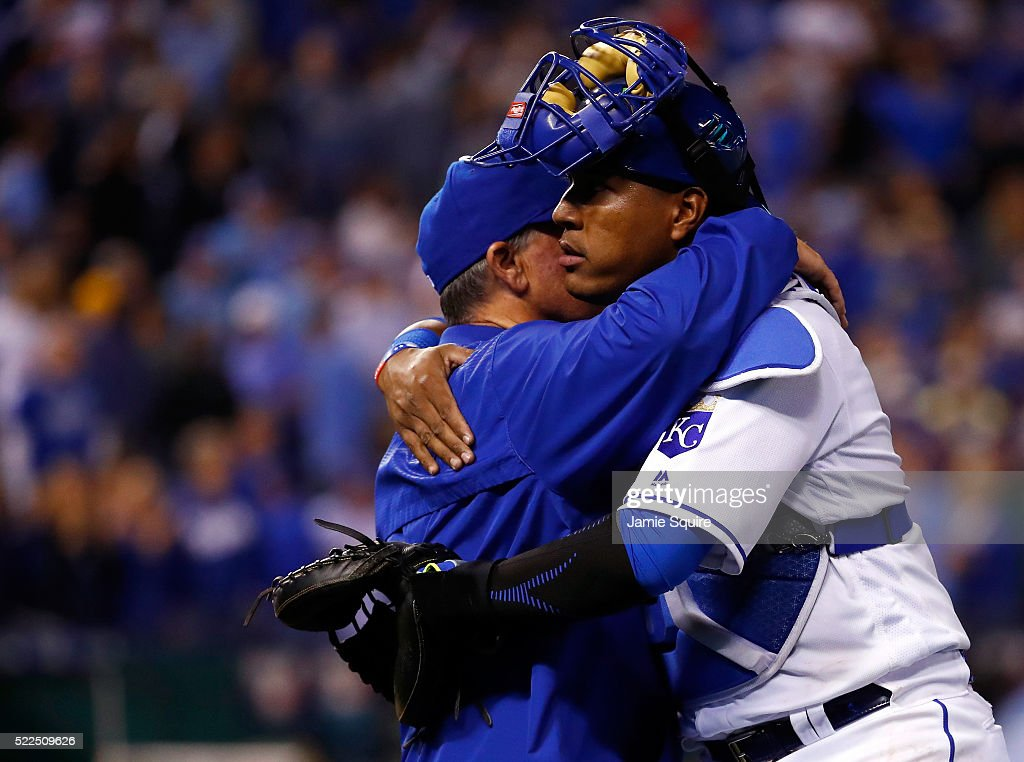 Catcher Salvador Perez #13 of the Kansas City Royals hugs manager Ned Yost #3 after the Royals defeated the Detroit Tigers 8-6 to win the game at Kauffman Stadium on April 19, 2016 in Kansas City, Missouri.