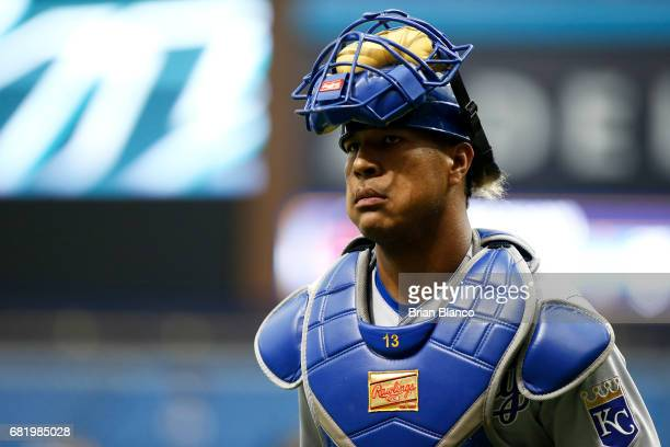 Catcher Salvador Perez of the Kansas City Royals makes his way to the dugout at the end of the third inning of a game against the Tampa Bay Rays on...