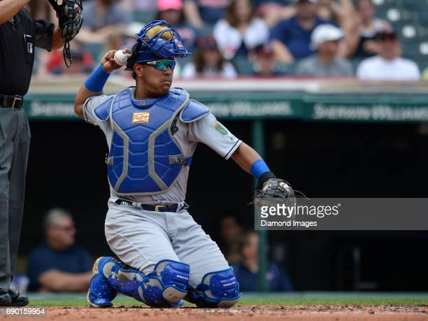 Catcher Salvador Perez of the Kansas City Royals throws the ball toward the pitchers mound during a game on May 28 2017 against the Cleveland Indians...