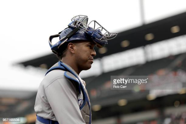 Catcher Salvador Perez of the Kansas City Royals walks to the dugout before the start of the Royals and Baltimore Orioles game at Oriole Park at...