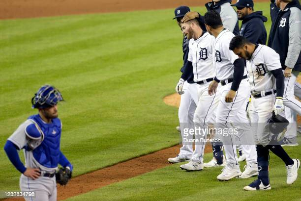 Catcher Sebastian Rivero of the Kansas City Royals reacts as Robbie Grossman of the Detroit Tigers is congratulated by teammates after hitting a...