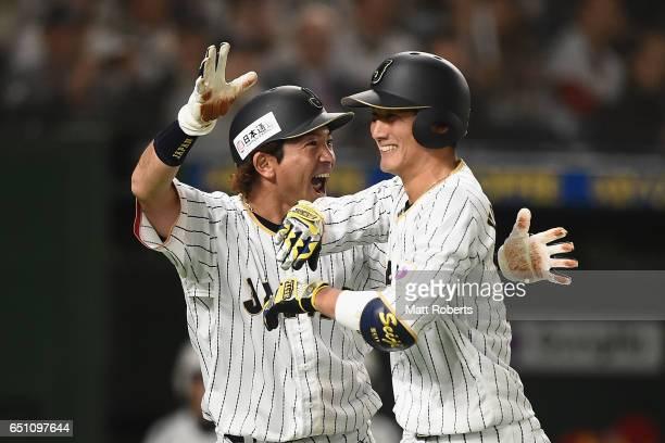 Catcher Seiji Kobayashi and Infielder Nobuhiro Matsuda celebrate during the World Baseball Classic Pool B Game Six between China and Japan at Tokyo...