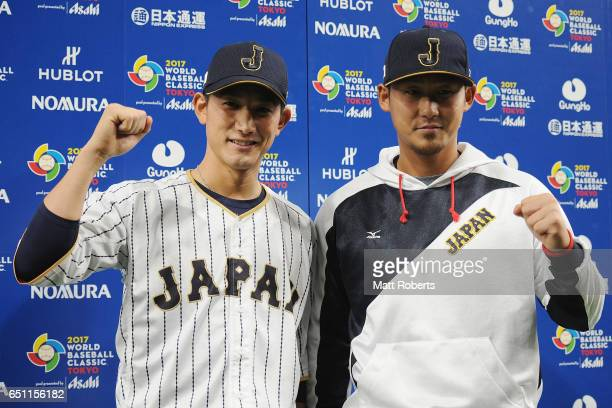 Catcher Seiji Kobayashi and Outfielder Sho Nakata of Japan pose for a photograph after the World Baseball Classic Pool B Game Six between China and...
