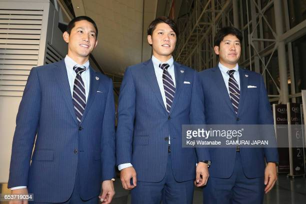 Catcher Seiji Kobayashi Infielder Hayato Sakamoto and Pitcher Tomoyuki Sugano of Japan pose for photographs on departure for the United States for...