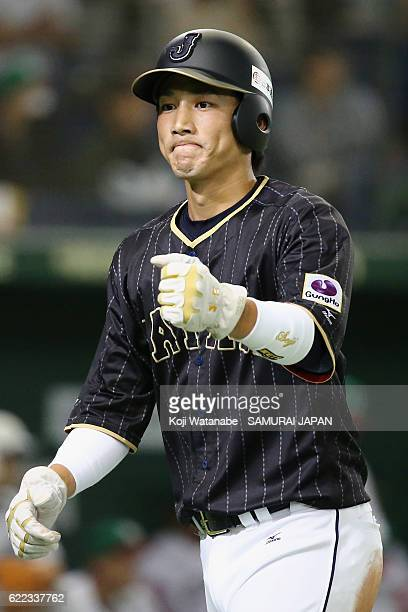 Catcher Seiji Kobayashi of Japan celebrates scoring by the RBI double of Outfielder Shogo Akiyama of Japan in the second inning during the...