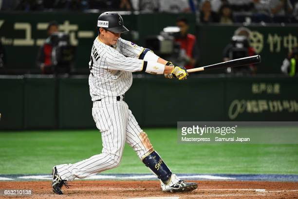 Catcher Seiji Kobayashi of Japan hits a RBI single to make it 55 in the bottom of the sixth inning during the World Baseball Classic Pool E Game Four...
