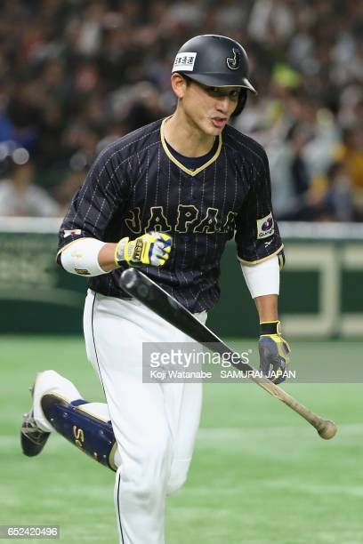 Catcher Seiji Kobayashi of Japan hits a RBI single to make it 65 in the top of the fifth inning during the World Baseball Classic Pool E Game Two...